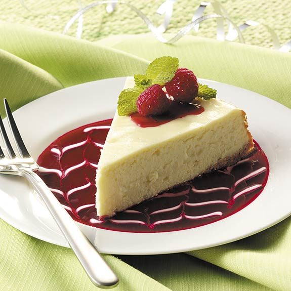 A slice of homemade cheesecake with a graham cracker crust.