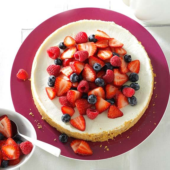 Easy no-bake cheesecake topped with blueberries, raspberries and strawberry slices.
