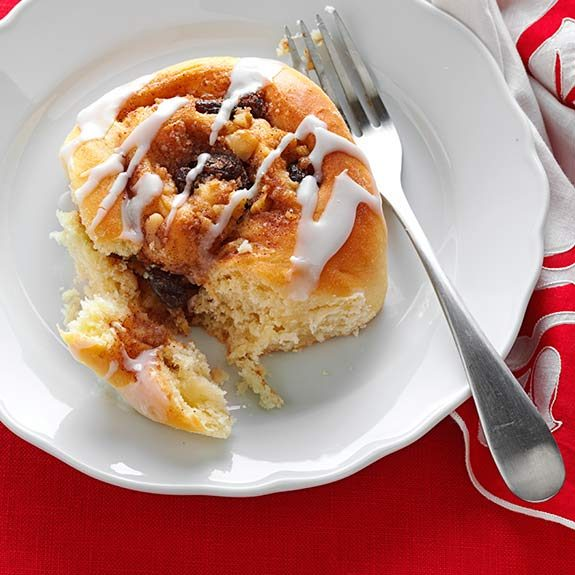 One homemade cinnamon roll drizzled with glaze.