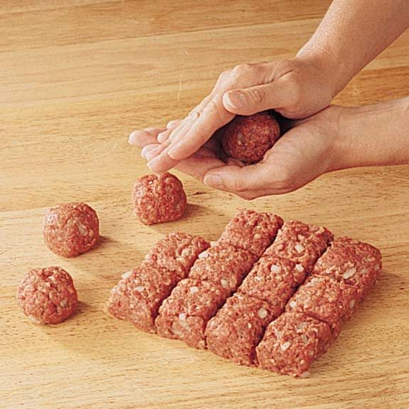 Gently rolling squares into round meatballs.