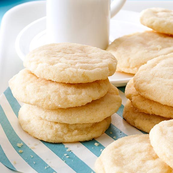Plate stacked with homemade sugar cookies.