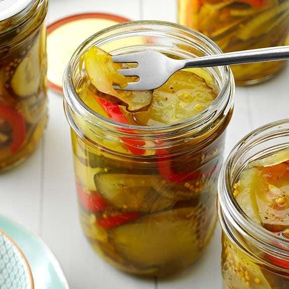 Homemade sweet pickles with sweet peppers and seasonings.