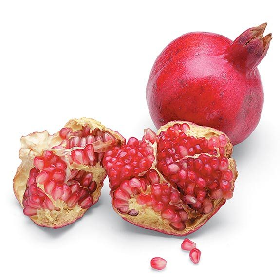 Open pomegranate with seeds.