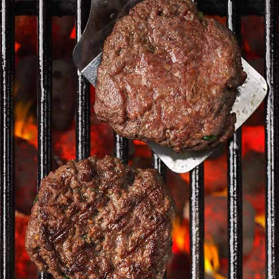 Cooking hamburgers on the grill.