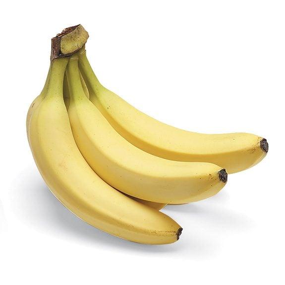 One bunch of three yellow bananas.