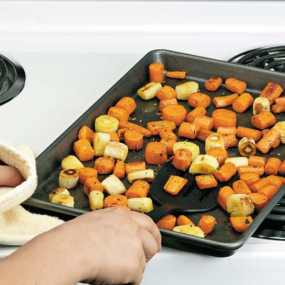 Roasting vegetables in a single layer on a baking sheet.
