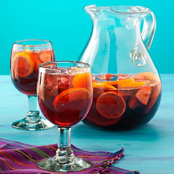 Pitcher of sangria with glasses.