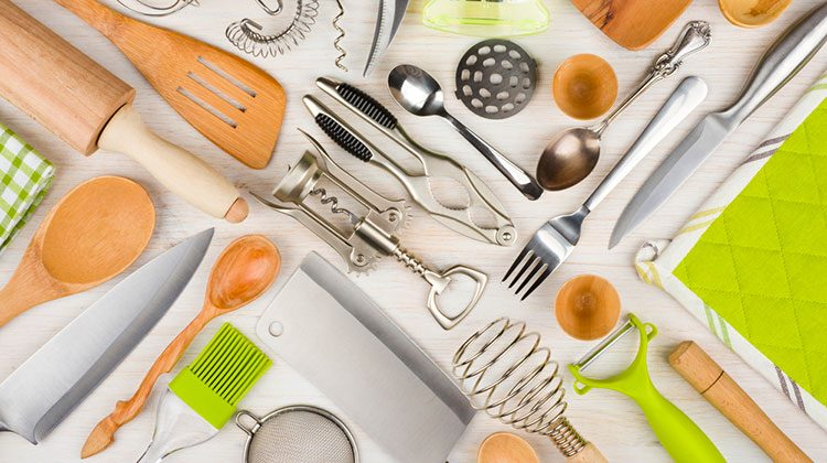 Various kitchen tools of different sizes and colors all arranged together