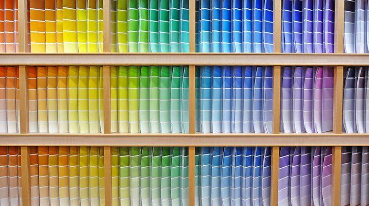 Three rows of paint swatches arranged in a rainbow pattern