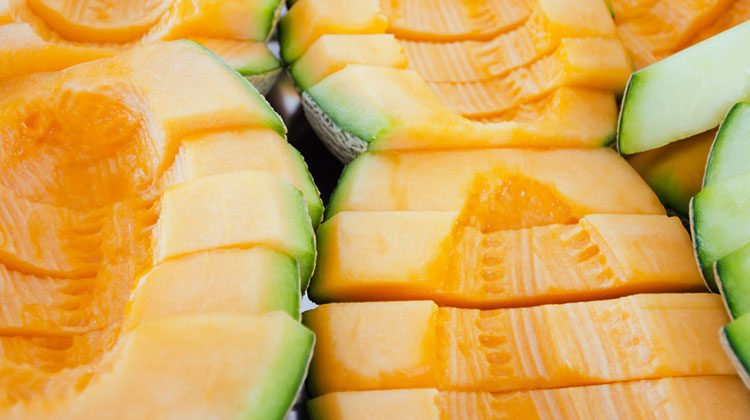 Thick slices of cantaloupe lined up in three rows