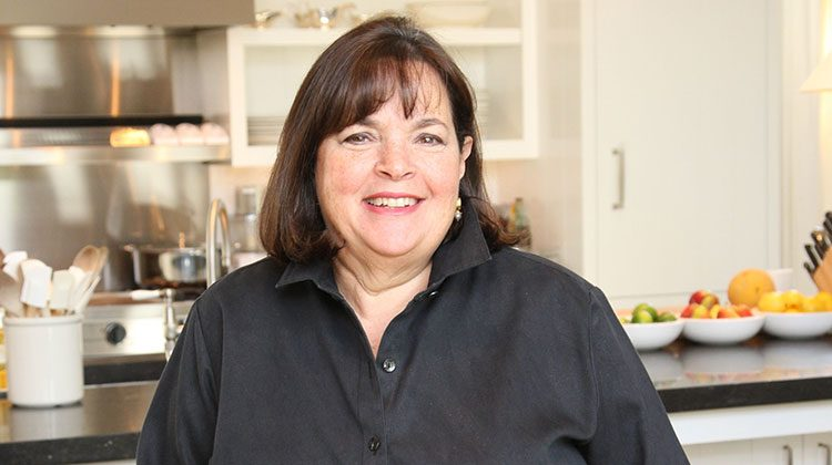 Ina Garten Standing In Front Of Her Kitchen And Smiling