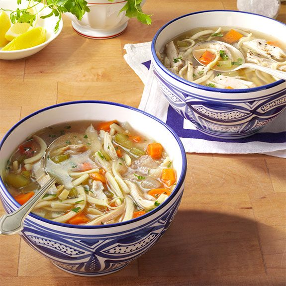 Two bowls of homemade chicken noodle soup