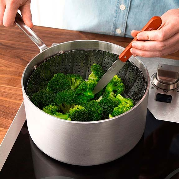 Steamed broccoli is done when you can easily pierce the thickest part with a knife.