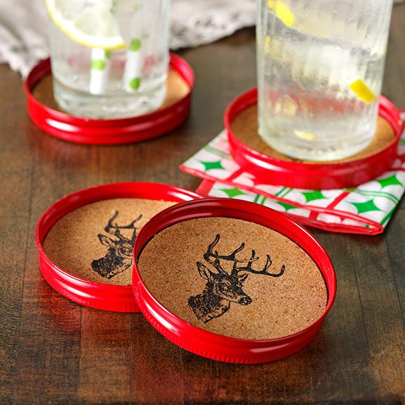 Coaster with a deer head design stamped into it placed inside of a canning lid