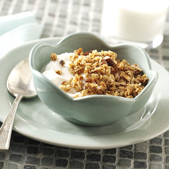 Homemade granola served over yogurt.