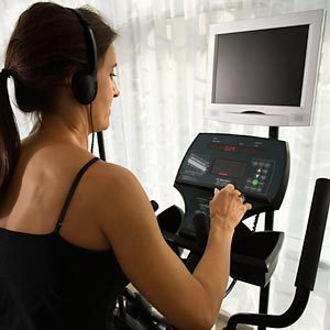 Woman exercising while wearing to headphones