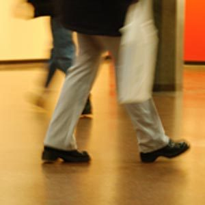 Close-up of feet walking in a mall
