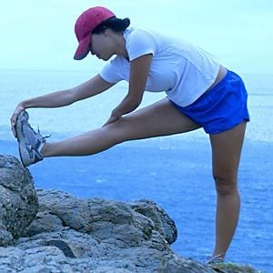 Woman stretching her leg before exercising