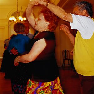 Couple square dancing together for exercise