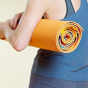 Woman carrying yoga mat