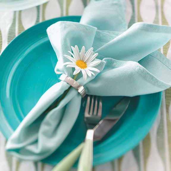 insert the stem of a fresh flower through the napkin ring
