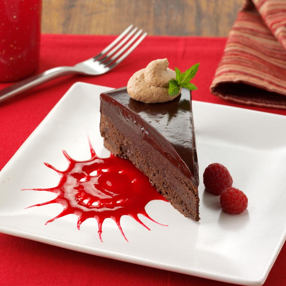 Flourless Chocolate Cake With Chocolate Mousse And Raspberry Sauce