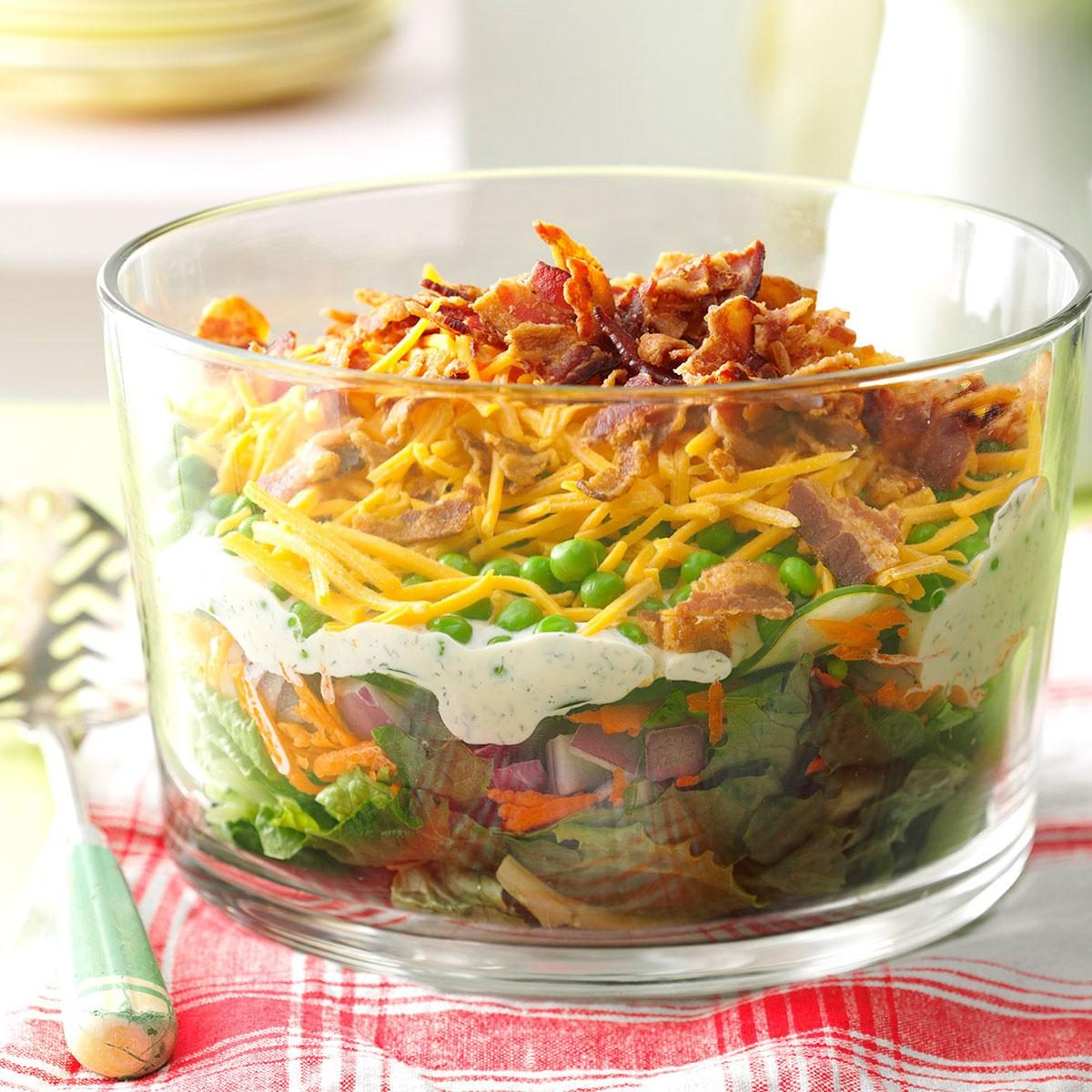 Layered salad for a crowd recipe taste of home for Easy tailgating recipes for a crowd