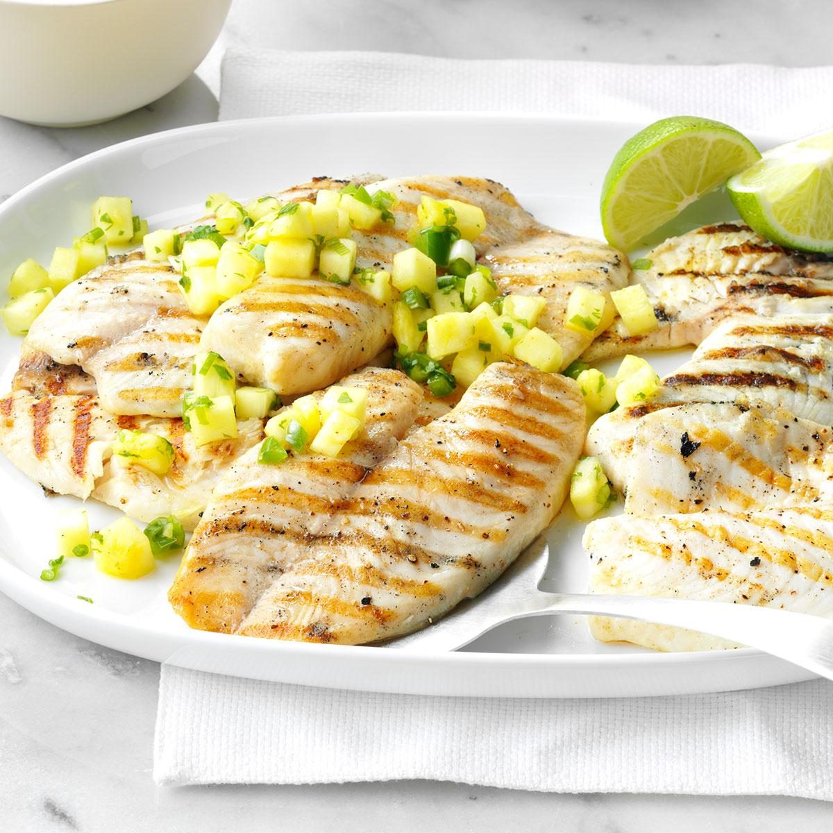 10 summer ready grilled fish recipes taste of home get recipe grilled tilapia with pineapple salsa ccuart Image collections