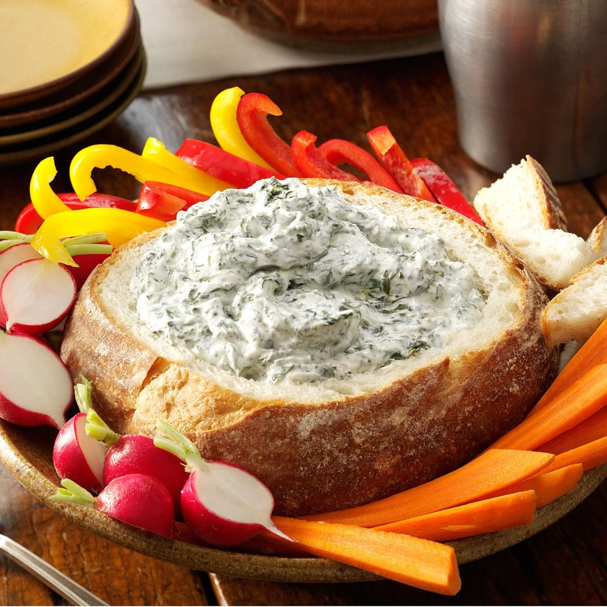 Spinach Dip is the classic of all dips in my book. You will see this dip at every family gathering we attend. Being able to serve it in a crusty bread bowl makes it even better yet! Bread bowl dips are perfect for any occasion. They are easy to make and always taste great. This Spinach Dip recipe even has a .