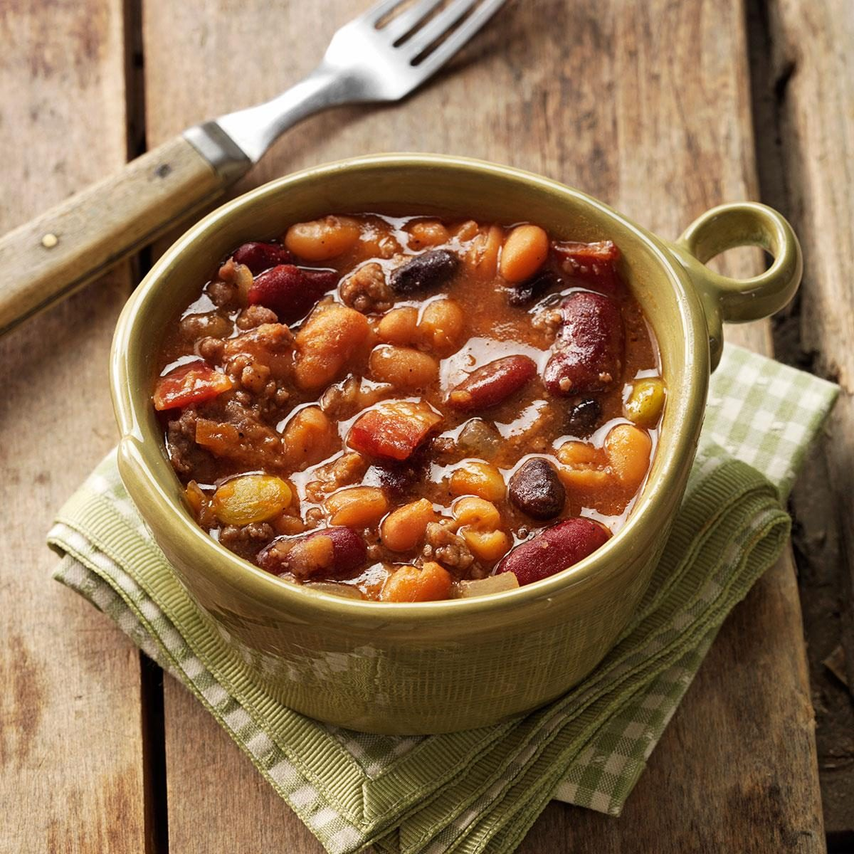 baked bean Step 1, watch how to make this recipe step 2, preheat oven to 350 degrees f step 3, in a dutch oven, mix onion, pork and beans, mustard, maple syrup, light brown sugar, ketchup, and lemon juice top with the bacon pieces bake, covered, for 45 to 60 minutes.