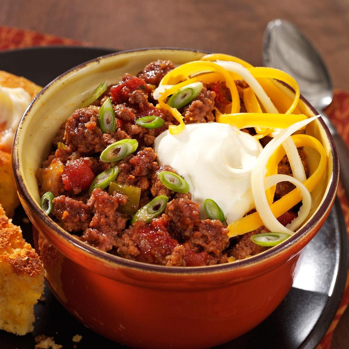With the addition of diced tomatoes, tomato sauce, green peppers and spices this chili has quickly become a favorite of mine. What is great about this recipe is that it uses the crock pot.