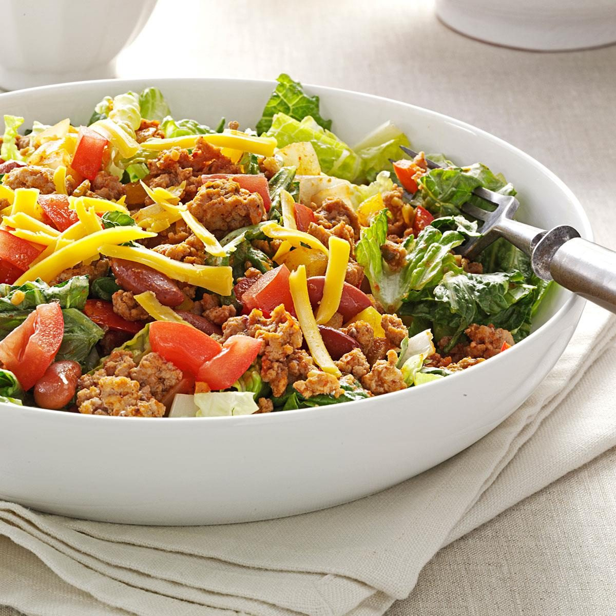 Dinner table with mexican food - Turkey Taco Salad