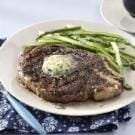Grilled Ribeyes with Herb Butter
