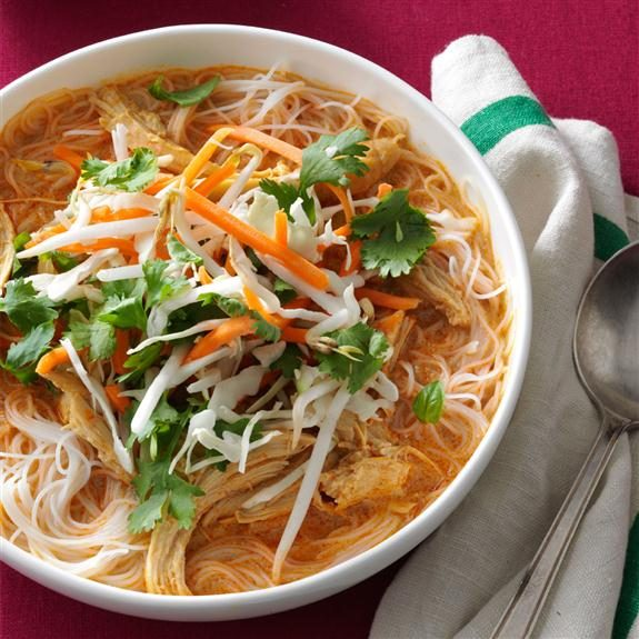 Asian-style chicken soup with rice noodles, chicken, cilantro, bean sprouts and carrots