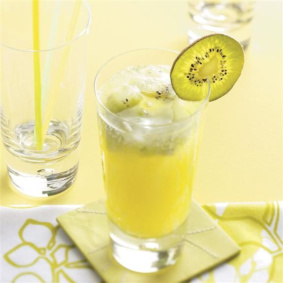 Sparkling kiwi lemonade in a frosty glass with a slice of kiwi as a decoration on the rim