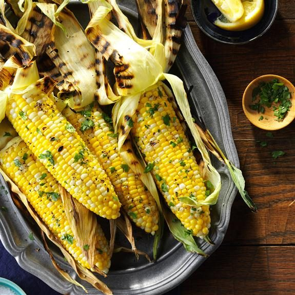 Buttered and seasoned grilled corn on the cob.