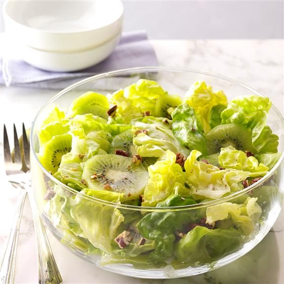 Fresh, green salad topped with kiwi slices